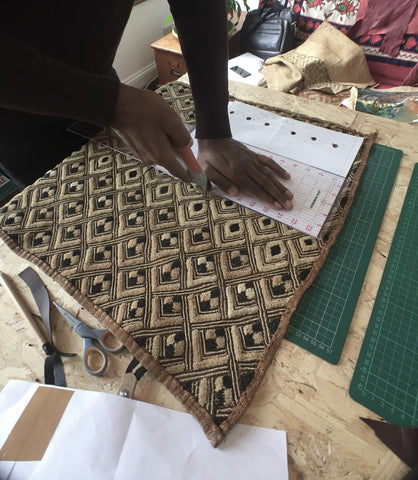 Kuba fabric being cut