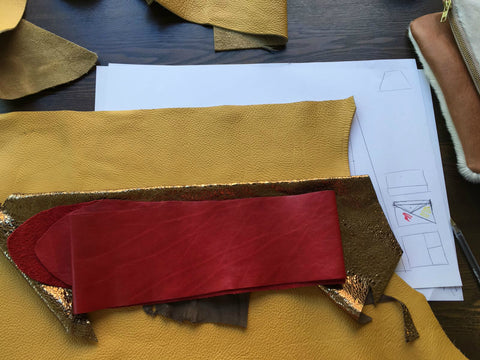 Using leather and drawings to design a clutch bag