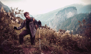 Man hiking mountain trails and wander. Summit along the forest with bearded man hiking and adventurer. A true wanderlust.