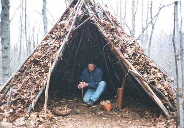 Making a shelter sticks and wood