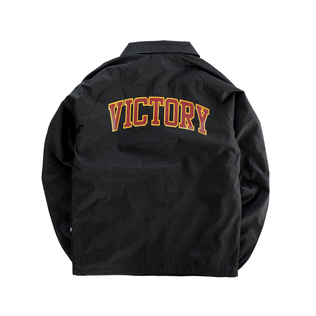 Premium quality sports showerproof coach jacket in black by New Zealand skate and streetwear clothing label VIC Apparel. Screen printed varsity logo design at back.