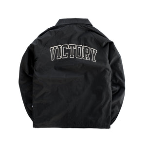 Premium quality sports showerproof coach jacket in black by New Zealand skate and streetwear clothing label VIC Apparel. Screen printed varsity logo design at back. 100% Oxford nylon matt finish, Regular fit, Lightweight microfibre Lining, Stash pocket inside the chest.