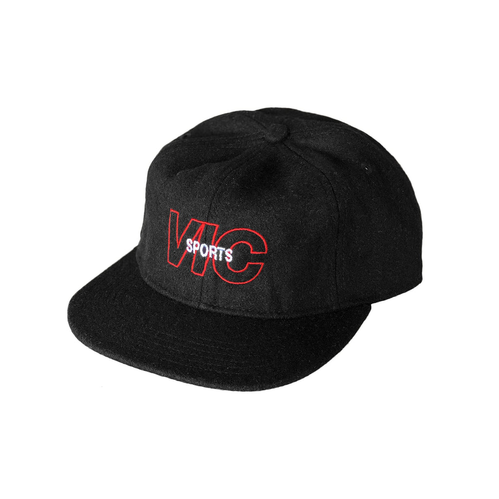 Premium quality 6-panel hat in black by New Zealand skate and streetwear clothing label VIC Apparel. Embroidered logo. Vintage baseball cap style. 50% wool 50% polyester.
