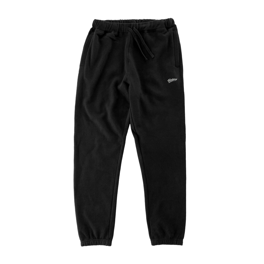 Cozy mid-weight sweat track pants in black by New Zealand skate and streetwear clothing label VIC Apparel. American 90s vintage classic sportswear regular fit. Minimal simple design.