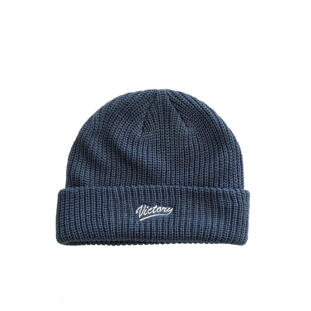 Premium quality knitted fisherman short body cuff beanie in blue dusk by New Zealand skate and streetwear clothing label VIC Apparel. Embroidered logo.