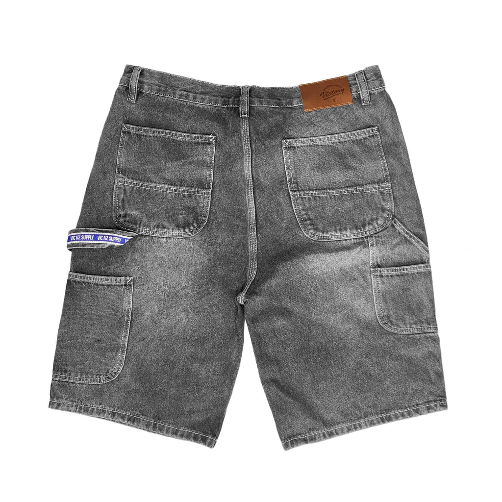 Premium quality carpenter denim shorts by New Zealand skate and streetwear clothing label VIC Apparel. New improved relaxed fit. Featuring utility pockets, a traditional hammer loop, and triple needle contrast stitching with the blue woven VIC patch on the hammer loop. Classic vintage workwear style.
