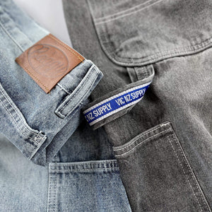 Premium quality carpenter jeans by New Zealand skate and streetwear clothing label VIC Apparel. Ultra baggy fit. Featuring utility pockets, a traditional hammer loop, and triple needle contrast stitching with the blue woven VIC patch on the hammer loop. 90s Classic vintage workwear work pant style.
