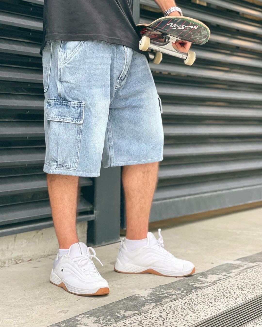 Premium quality cargo denim jean shorts by New Zealand skate and streetwear clothing label VIC Apparel. Loose fit. Featuring utility pockets and triple needle contrast stitching with VIC label flag at the back right pocket. Classic vintage workwear style.