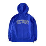 VIC Club Champion® packable anorak in royal blue. Classic athletic fit. Water and wind-resistant. American classic vintage sportswear style. Varsity logo design.