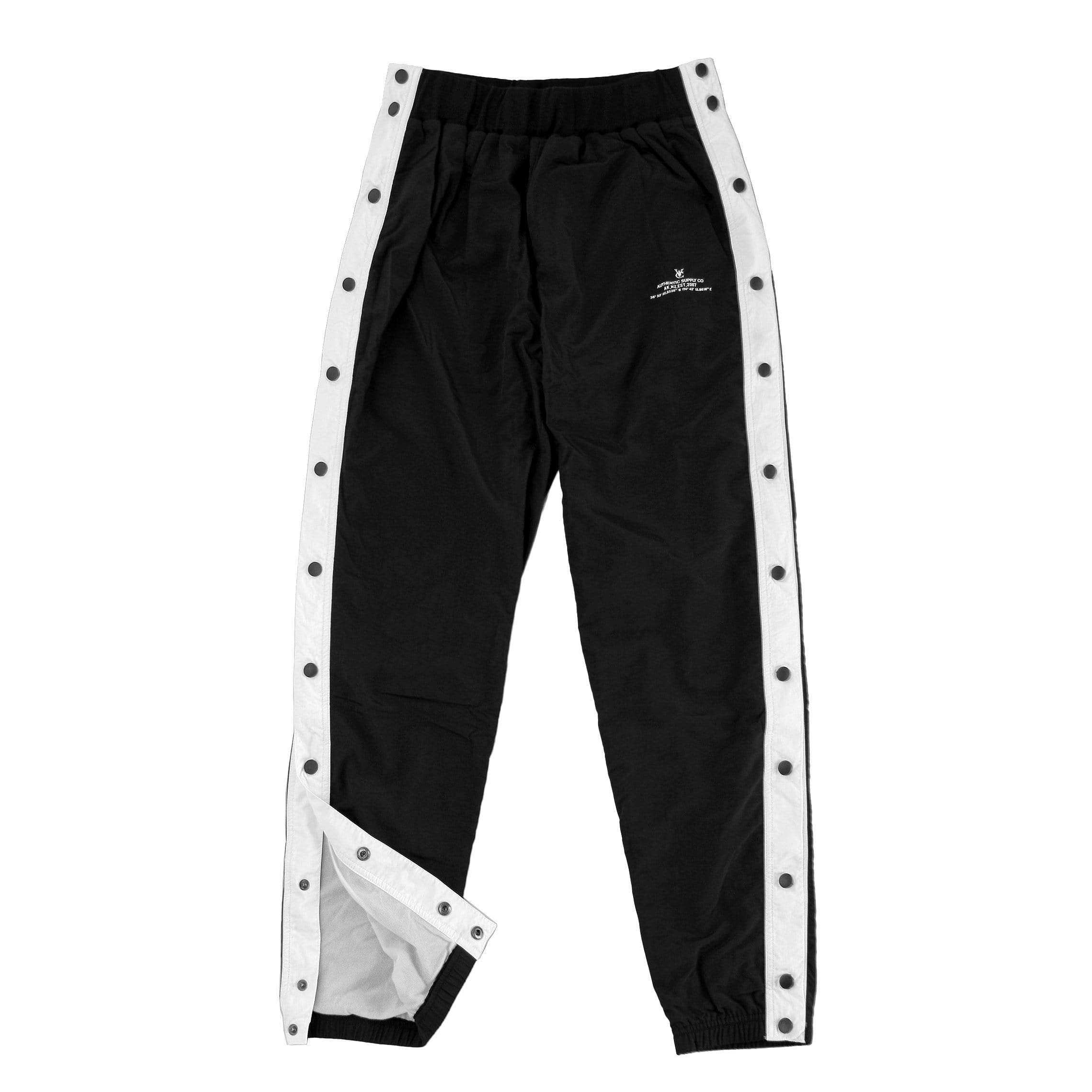 Men's and Women's Warm up tearaway snap track pants in black by New Zealand skate and streetwear clothing label VIC Apparel. American 90s vintage sportswear style. Slim fit.