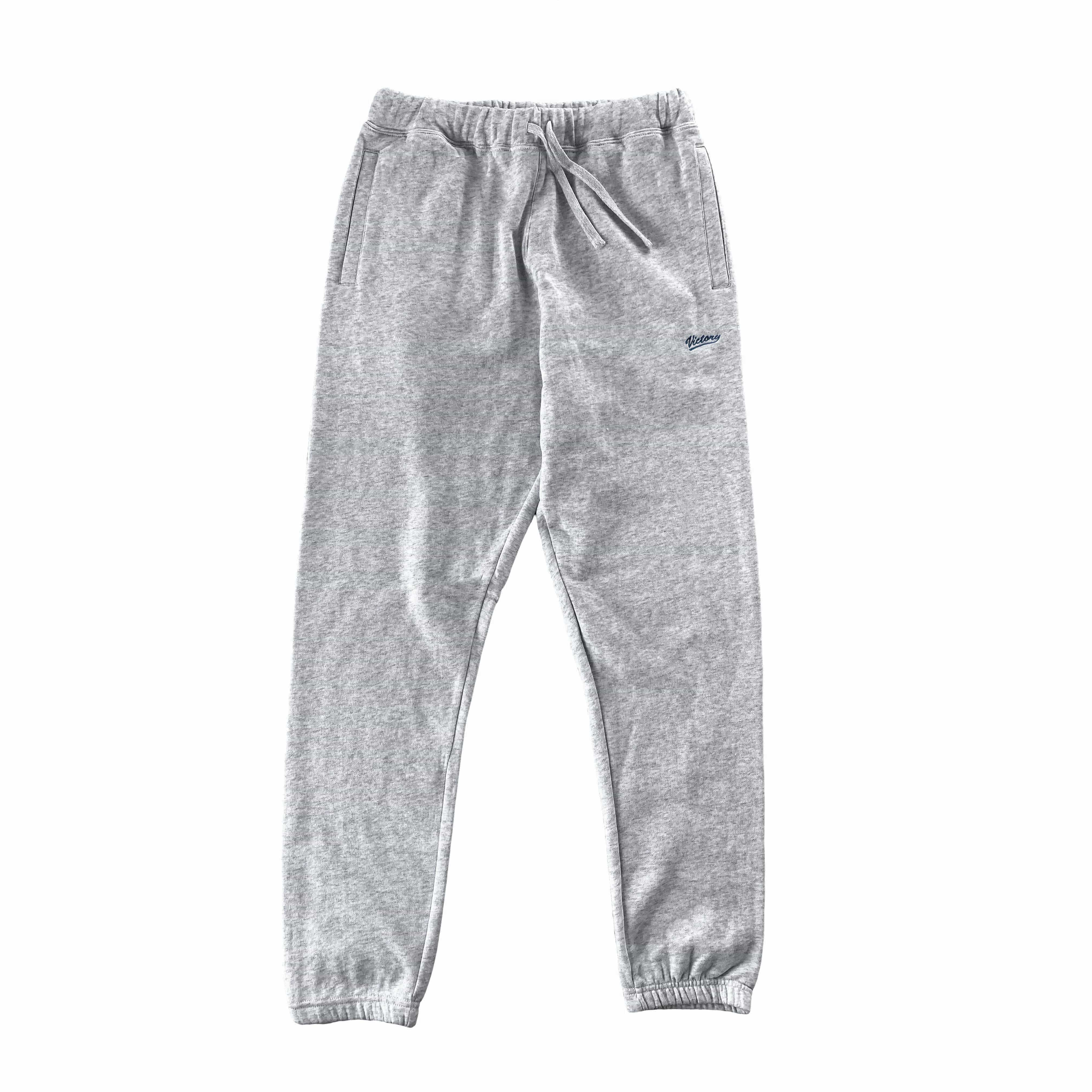 Cozy mid-weight sweat track pants in ash grey by New Zealand skate and streetwear clothing label VIC Apparel. American 90s vintage classic sportswear regular fit. Minimal simple design.