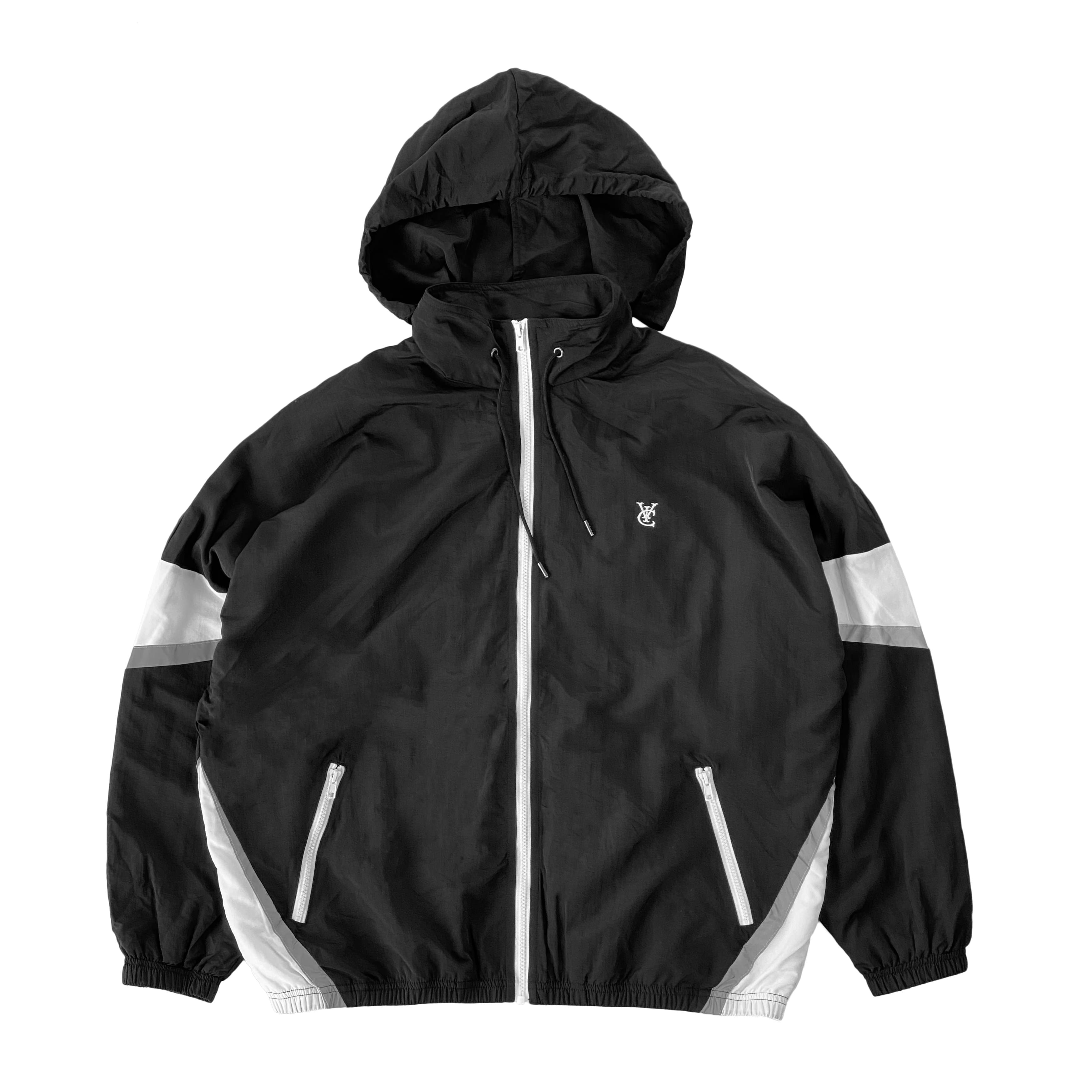 Feather Windbreaker Track Jacket by NZ skate and streetwear brand VIC Apparel. Classic relaxed fit. Shower proof. American classic vintage 80s & 90s sportswear style. Drawcord-adjustable, packable hood can be stowed in collar. Reflective detailing on sleeves & waist. Logo embroidery