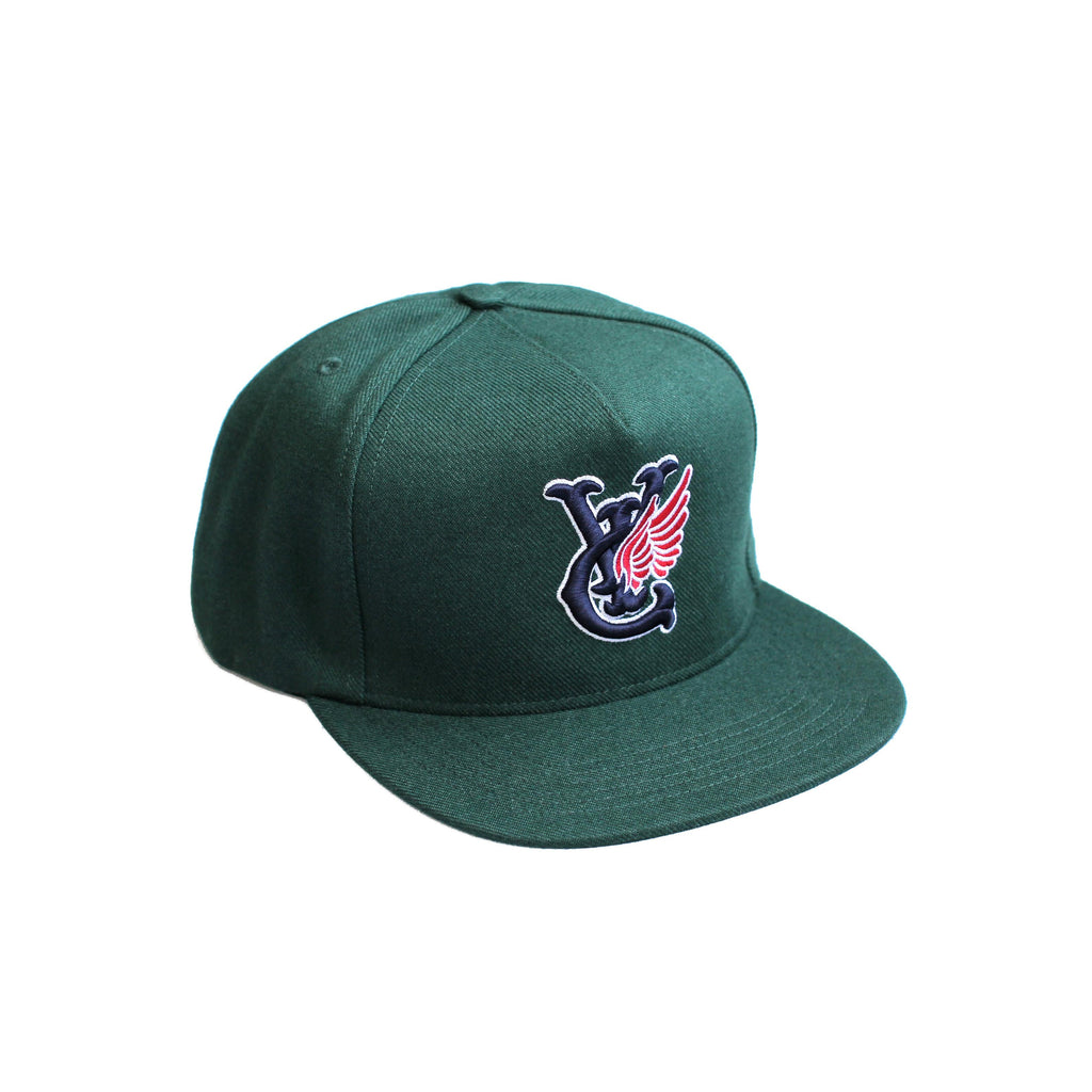 Premium quality baseball snapback hat in forest green by New Zealand skate and streetwear clothing label VIC Apparel. Embroidered logo. A-frame snapback cap style, hand made in the USA.