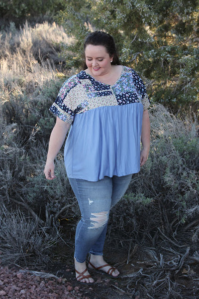 Plus size floral flowy blouse in blue.