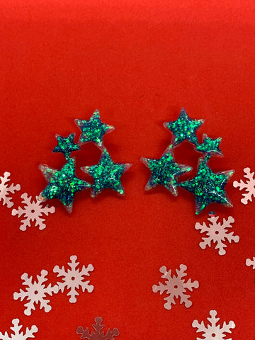 Glittery blue star earrings