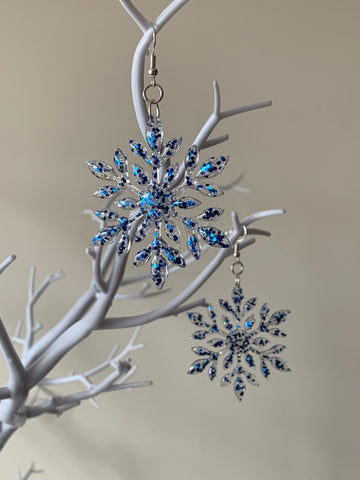 Blue sparkly snowflake earrings