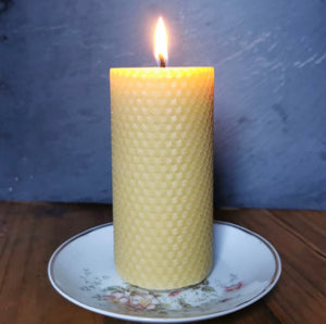 Lit handrolled beeswax candle
