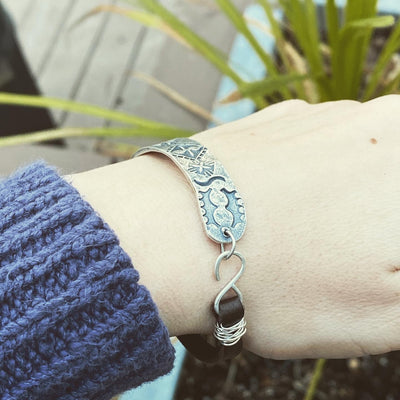 Stamped fine silver and leather bracelet