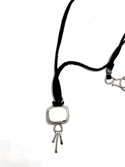 White buffalo tassel necklace on black leather