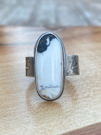 Long oval white buffalo on wide stamped band