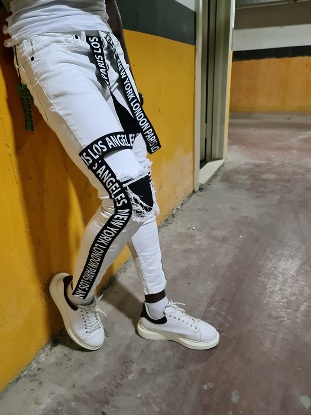 White Jeans With Black Strap With Distress