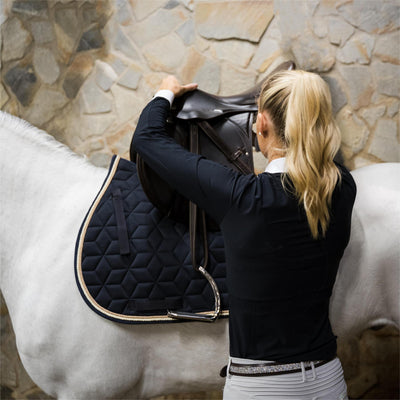 What kind of a saddle pad can I have at horse shows?