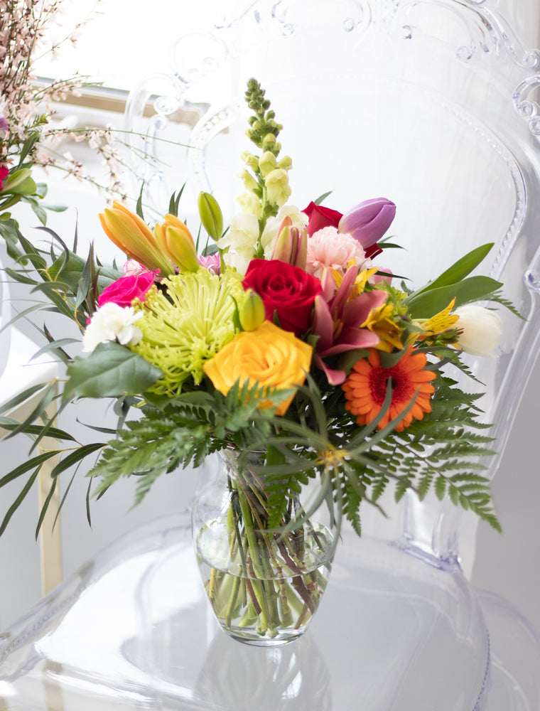 Fun and Vibrant vase arrangement flower delivery in Red Deer Alberta