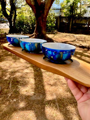 Serving paddle with bowls