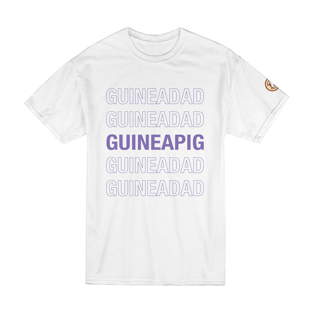 Flay Lay of White GuineaDad T-Shirt With Purple Lettering Guinea Pig in Sizes Small Medium Large XL