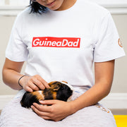 Guinea Pig held by woman wearing White GuineaDad T-Shirt Red Block Logo in sizes Small Medium Large XL