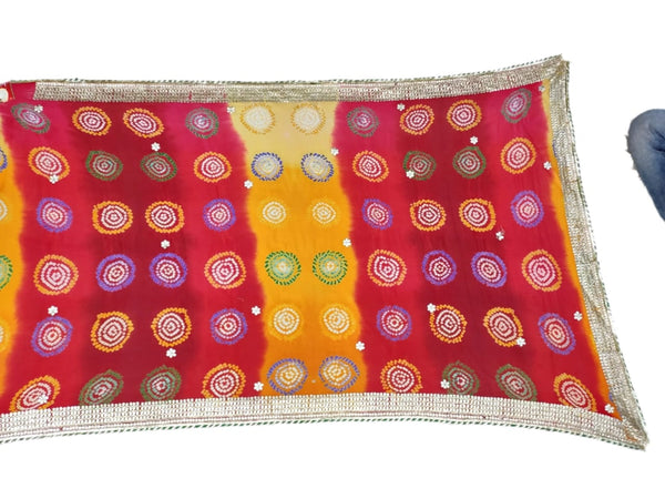 Golden And Red Shaded Color Pure Crepe Bandhani Saree