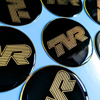 TVR black & silver / gold / white resin domed wheel badge