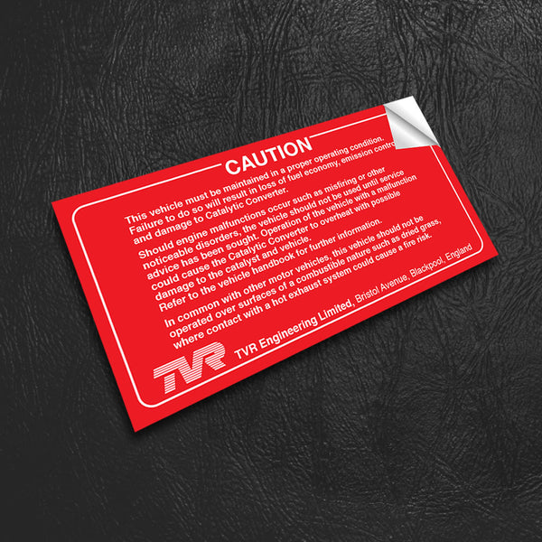 "TVR sun visor sticker - ""CAUTION"" - red with white text"