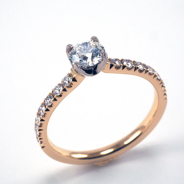 Round Solitaire with Diamond shoulders - 0.65ct