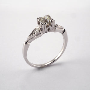 Round Solitaire with Diamond shoulders 0.49ct