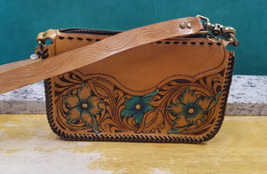 Purse with turquoise flowers and leather braiding