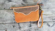 Load image into Gallery viewer, Hand tooled leather wristlet with orange chap leather body