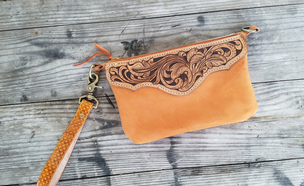 Hand tooled leather wristlet with orange chap leather body