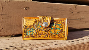 Tooled leather clutch wallet