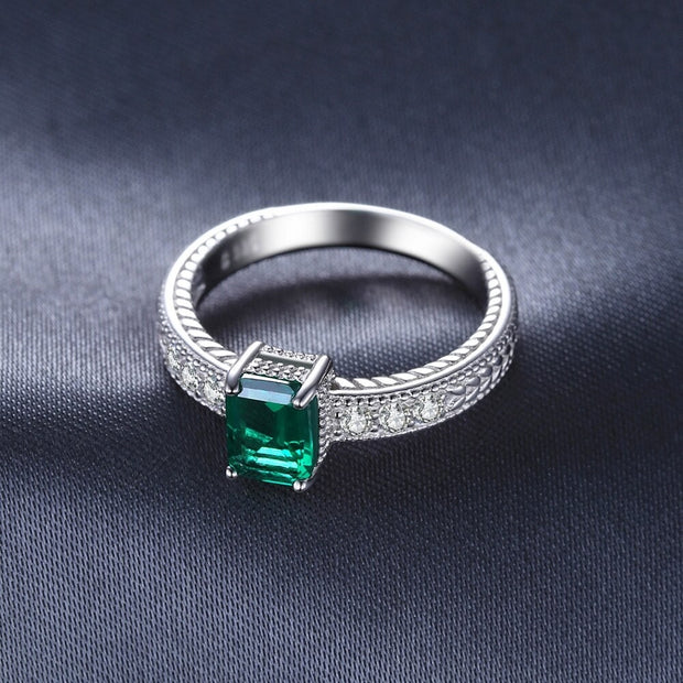 Emerald Cut Emerald Ring with Diamonds
