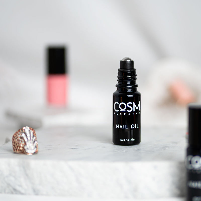 COSM Research Nail + Cuticle Oil is an oil blend formulated with minimal ingredients to rescue and reduce nail and cuticle issues, restore nail color, and remove build-up within the surrounding inflamed skin.