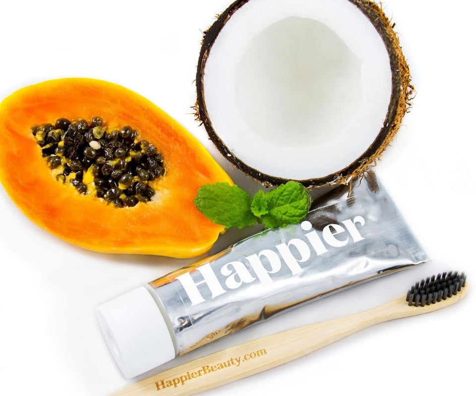 Happier beauty toothpaste subscription. Image shows Happier Beauty toothpaste ingredients including mint, papaya and coconut