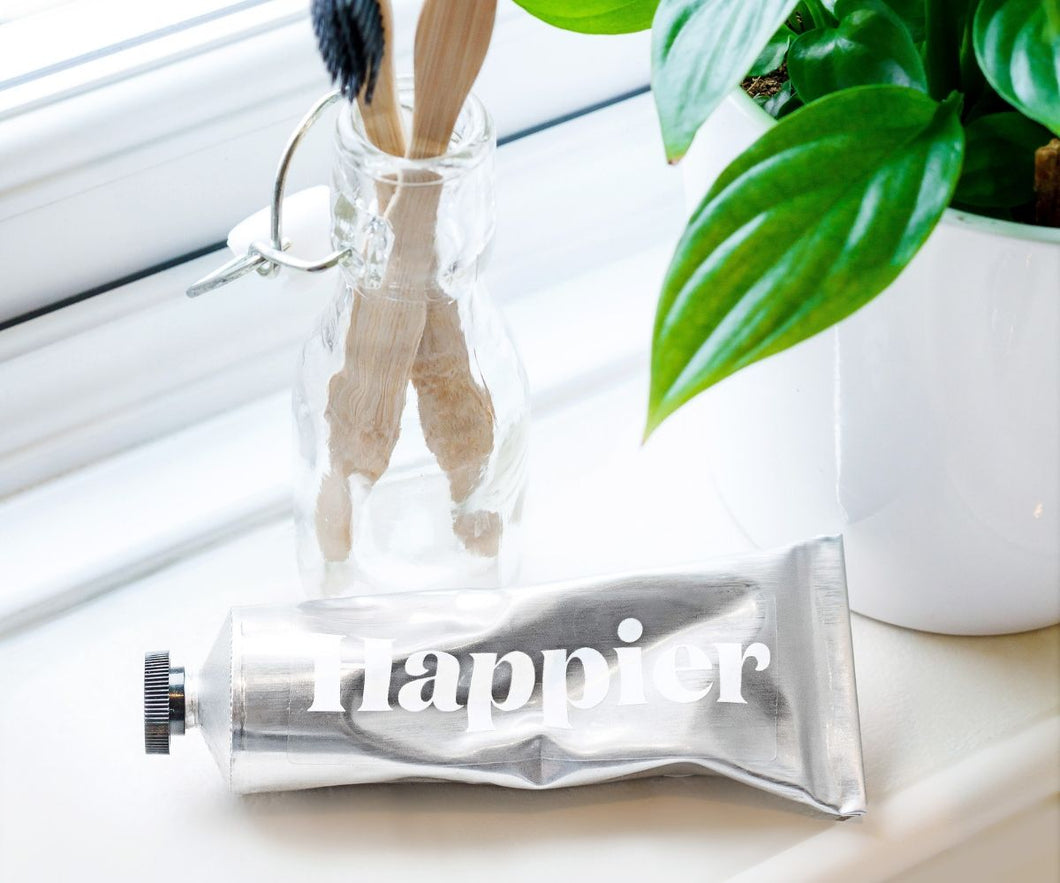 Happier Beauty toothpaste vegan natural no plastic packaging