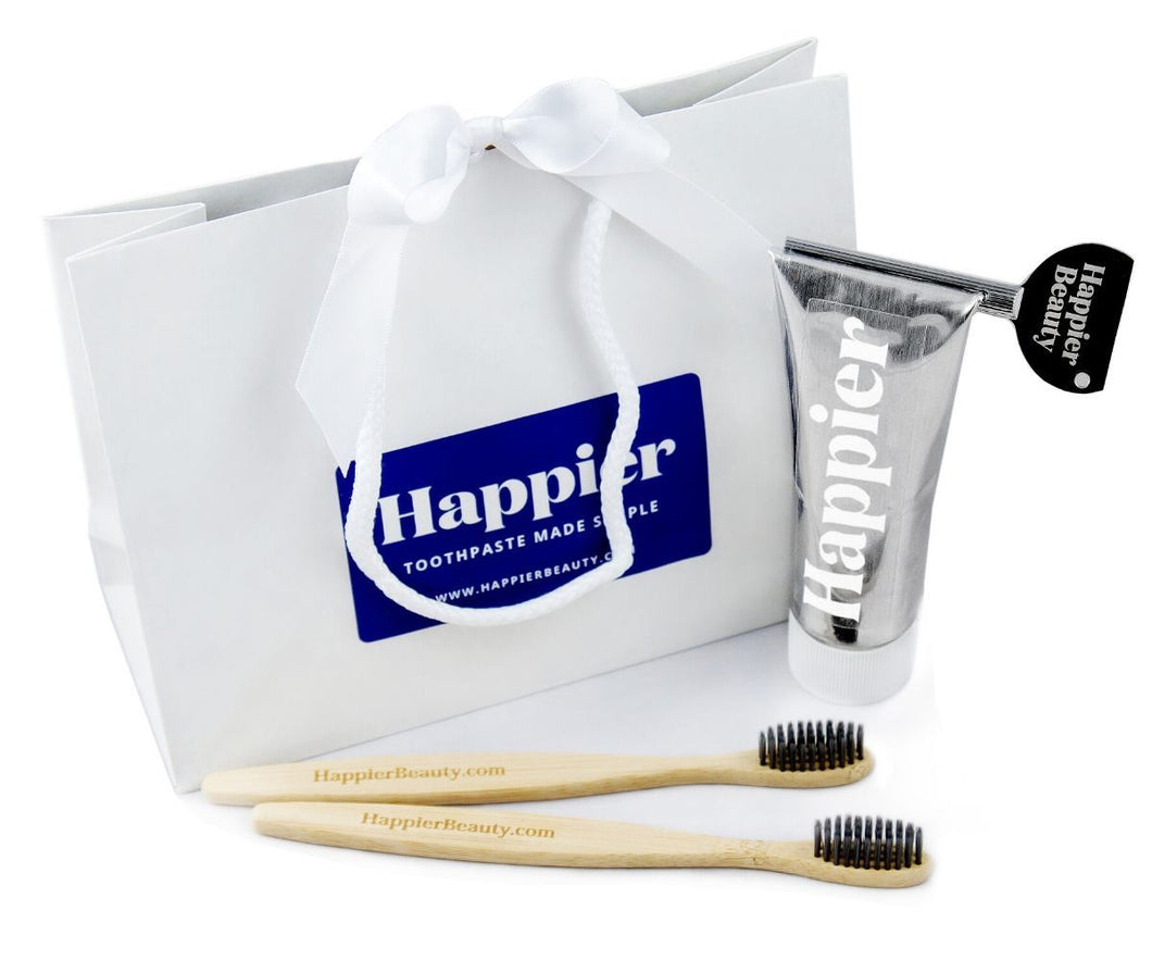 Happier Beauty Gifting bundle. Toothpaste, toothbrushes, Easy Squeezer key