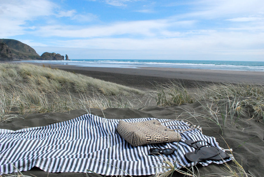 Ahoy Towel - Black - Stowaway on Piha Beach