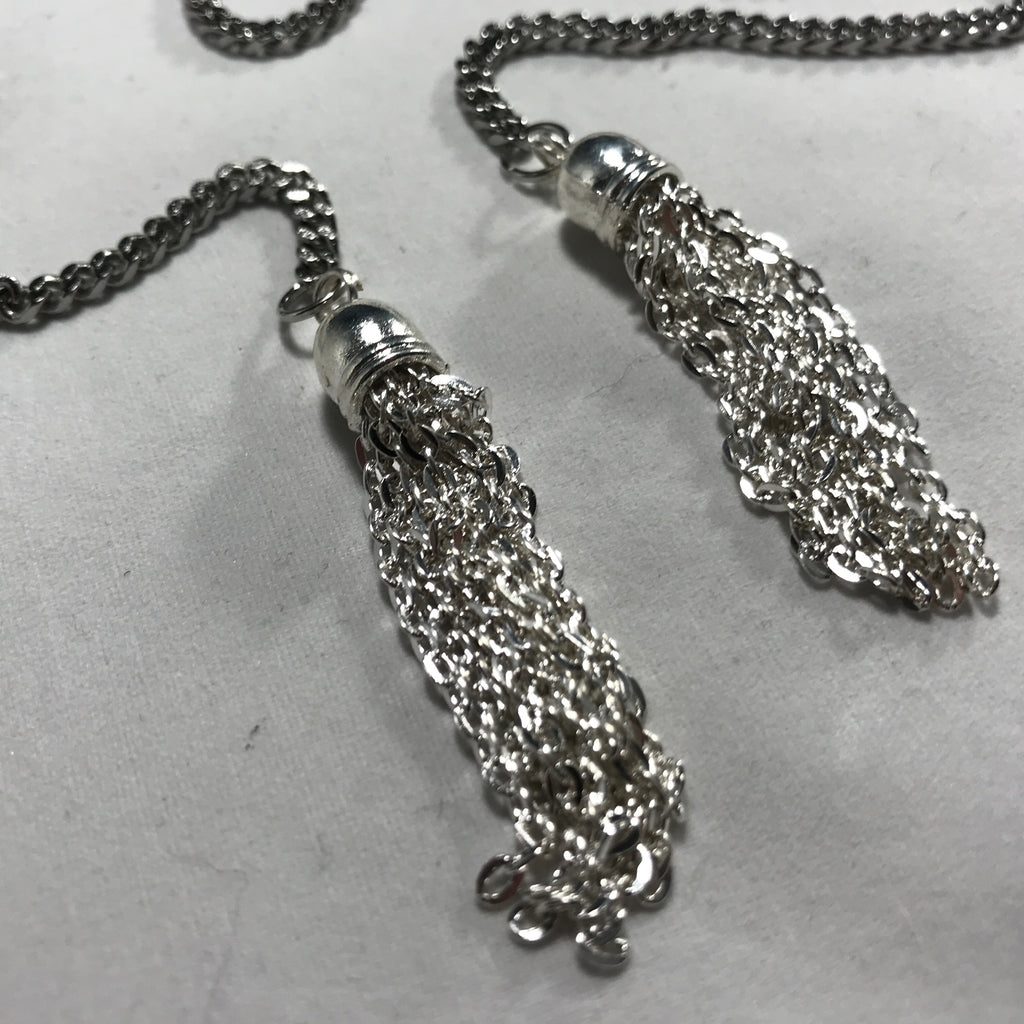 Silver chains with silver tassels