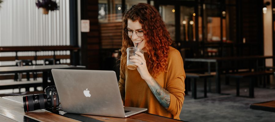 Young woman with eyeglasses working at a computer