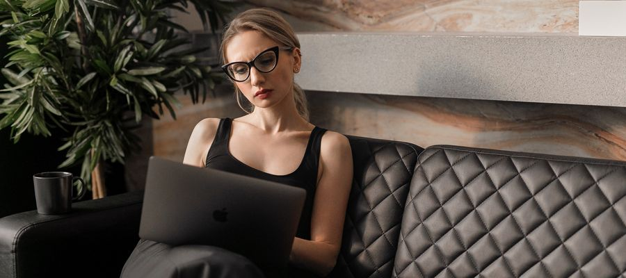 woman with eyeglasses tired before computer