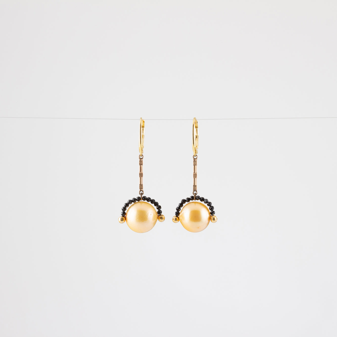 NOISE CANCELING PEARL EARRINGS // SPINEL