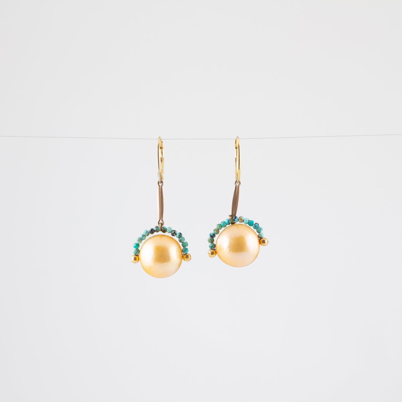 NOISE CANCELING PEARL EARRINGS // TURQUOISE